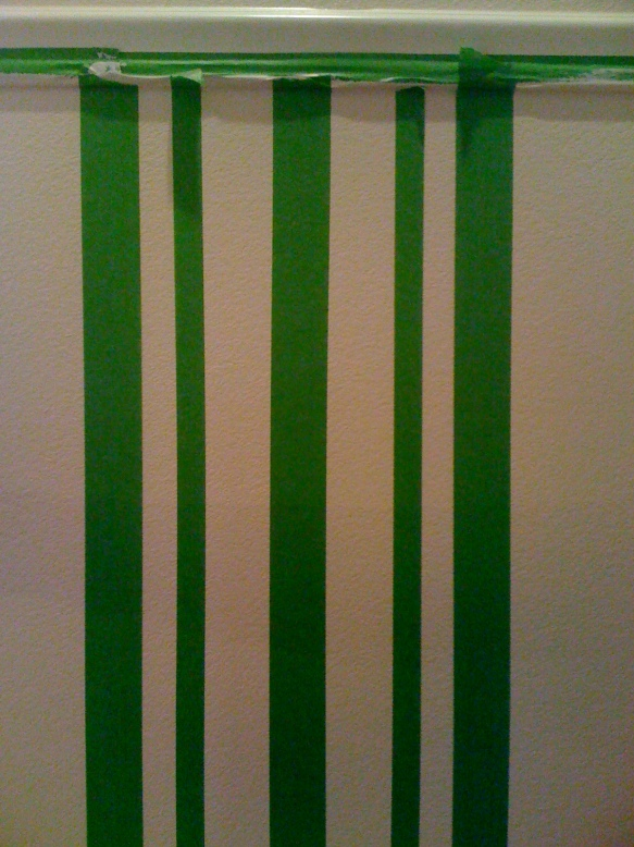 Stripe pattern is created by adding more pieces of tape in varying widths on either side of the wide stripes