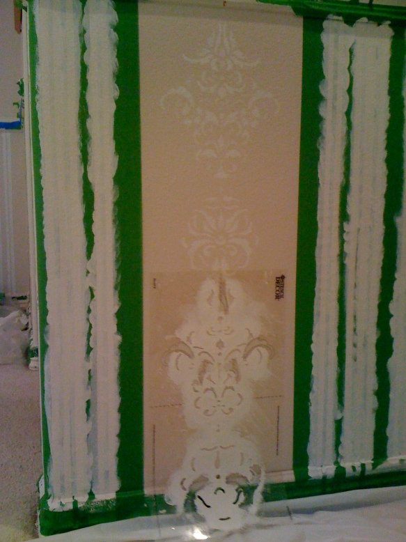 Stencil is repositioned down the wall to continue pattern